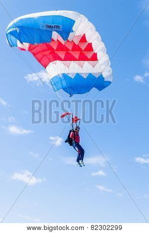 Paratrooper girl descends