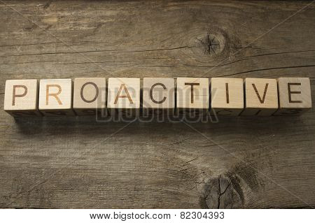 Proactive Concept text on a wooden background