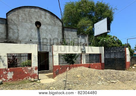 Delapidated Church With Blank Sign