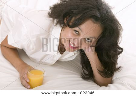 Young Asian Woman In Bed
