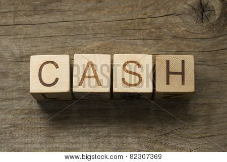 Cash word on a wooden toy blocks