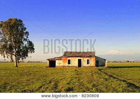 Abandoned House On Sicily In Front Of The Mount Etna