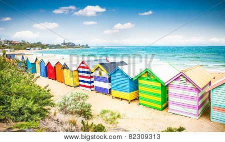 Beautiful Bathing houses on white sandy beach at Brighton beach in Melbourne, Australia.