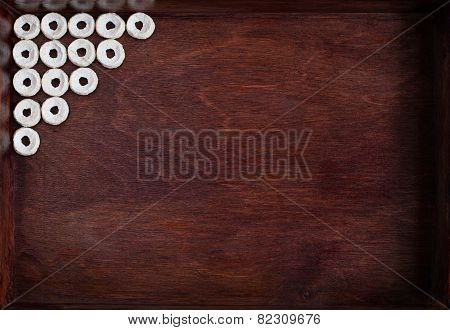 Cheerios Lined As Angle Into Dark Wood Box