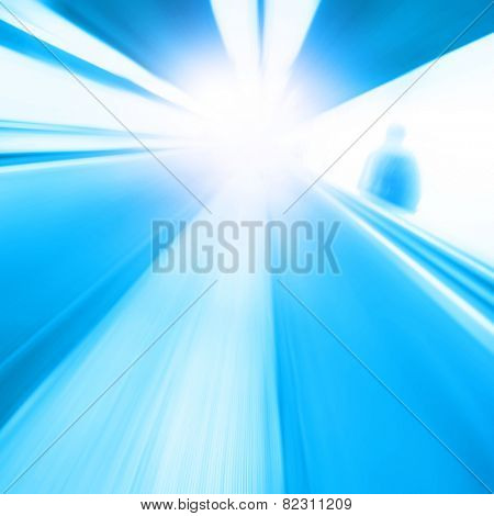 Abstract image of moving walkway and motion blurred man.