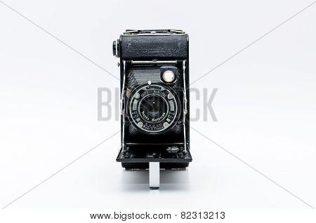 Old vintage camera on white background