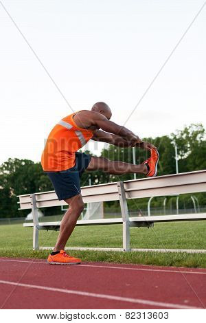 Track and Field Runner Stretching