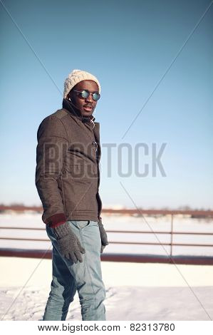 Fashion, Clothes And People Concept - Stylish Young African Man Outdoors In The Winter