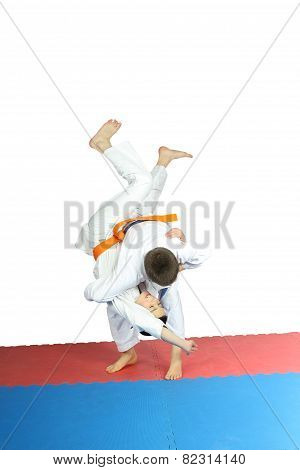 High throw is doing  an athlete with a blue belt