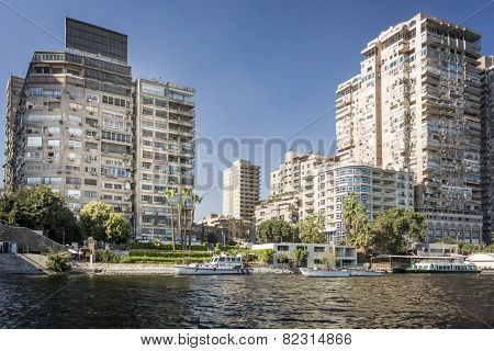 Tower Blocks On The Banks Of The River Nile