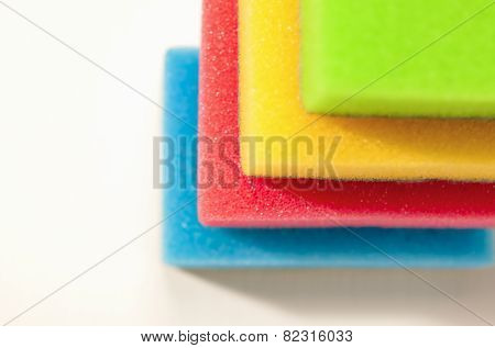 Kitchen Houseware And Utensils Concept: Colorful Sponges In One Stack Together