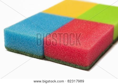 Houseware Concept: Four Colorful Kitchen Sponges Together. Isolated Over White Background