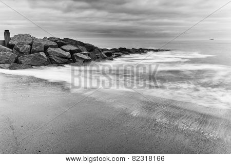 Milky white sea splashing over rocks