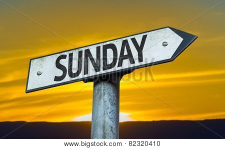 Sunday sign with a sunset background
