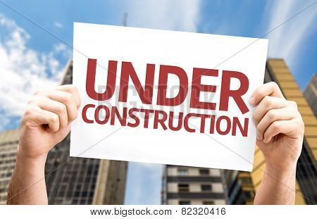 Under Construction card with a urban background