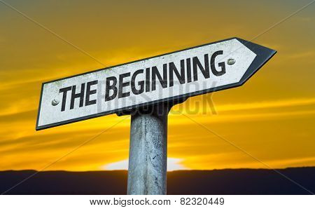 The Beginning sign with a sunset background