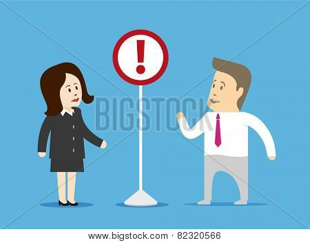Businessman and businesswoman looking at a sign installed