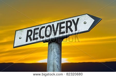 Recovery sign with a sunset background
