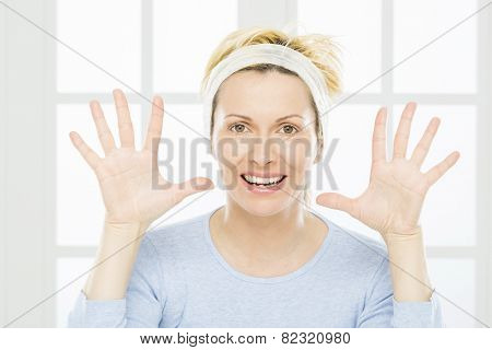 Forty years woman with opened hands