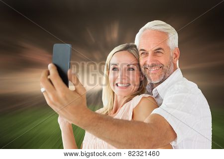 Happy couple posing for a selfie against stormy sky over city