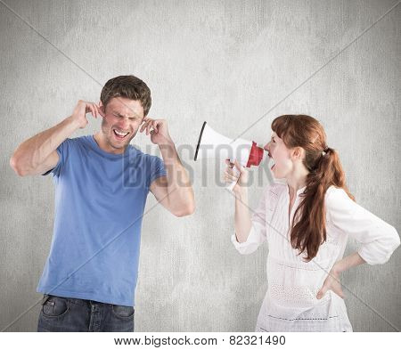 Woman shouting through a megaphone against weathered surface