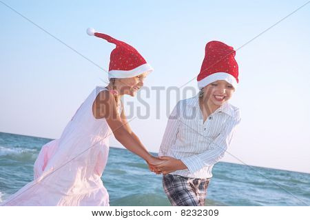 Santa Children On The Beach