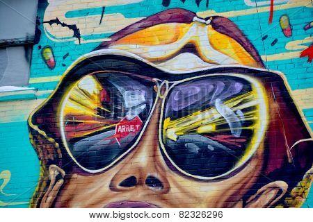 Street art Montreal junky sunglasses