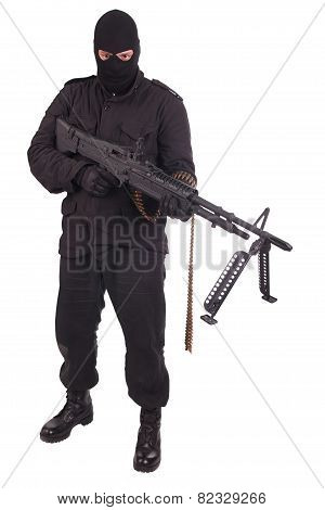 Man In Black Uniform With Machine Gun