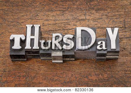 Thursday word in mixed vintage metal type printing blocks over grunge wood