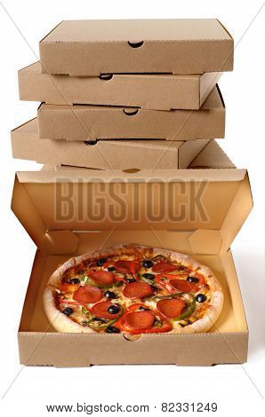 Freshly Baked Pizza With Stack Of Delivery Boxes