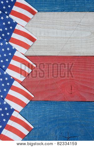 High angle shot of American Flag napkins spread out on a red, white and blue picnic table. Vertical format with copy space. Suitable for American Holidays: 4th of July and Memorial Day,