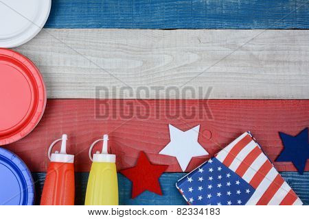 High angle shot of a patriotic red, white and blue picnic table. Horizontal format with copy space. Perfect for American Holidays: 4th of July, Memorial Day or Veterans Day.