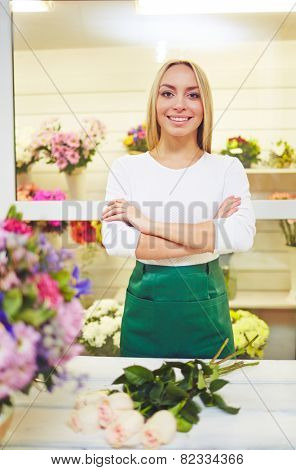 Fresh flower seller looking at camera with smile