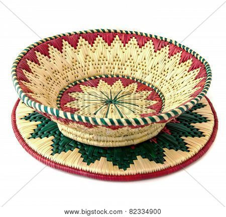 wicker basket on mat isolated