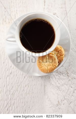 top view of black coffee and biscuits