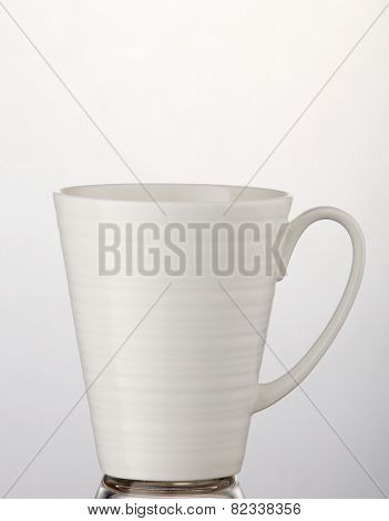 white mug on the white background