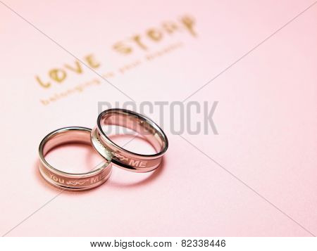 two ring on top of a book-love story