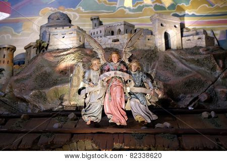 GRAZ, AUSTRIA - JANUARY 10, 2015: Angel with Gloria in excelsis Deo Banner, Nativity Scene in Franciscan Church in Graz, Styria, Austria on January 10, 2015.