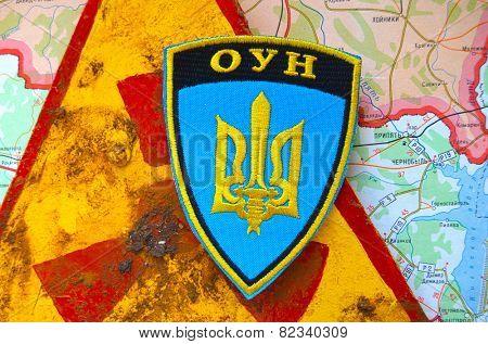 Kiev,Ukraine.JAN 10: Chevron of Ukrainian Nationalist Organisation -OUN,with sign Radioactive and Chernobyl area as background. At January 10,2015 in Kiev, Ukraine