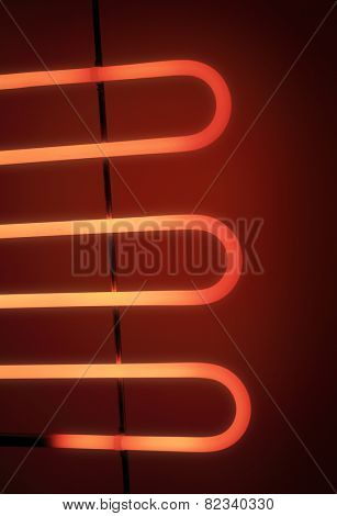 Electrical heating element of an electrical barbeque grill glowing in the dark.