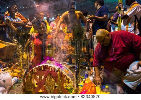 KUALA LUMPUR, MALAYSIA - FEBRUARY 3, 2015: Hindu devotees perform prayers at the Batu Caves temple on Thaipusam day. Hundreds of thousands of devotees come here for the Thaipusam prayers.