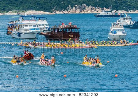 Hong Kong, China- June 2 , 2014: People racing the Dragon boats festival race in Stanley beach