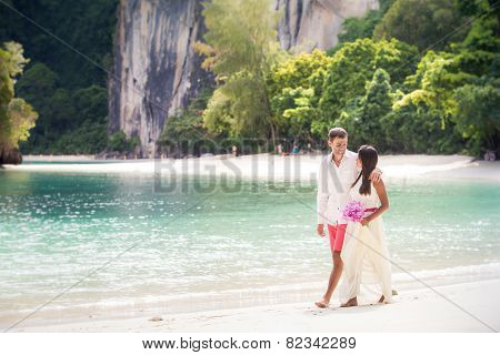 Handsome Groom Walk With Young Brunette Bride