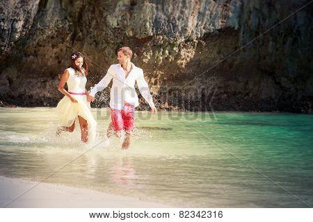 Groom And Brunette Bride Run