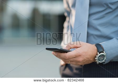 Closeup Of A Businessman's Hand Holding Cellphone