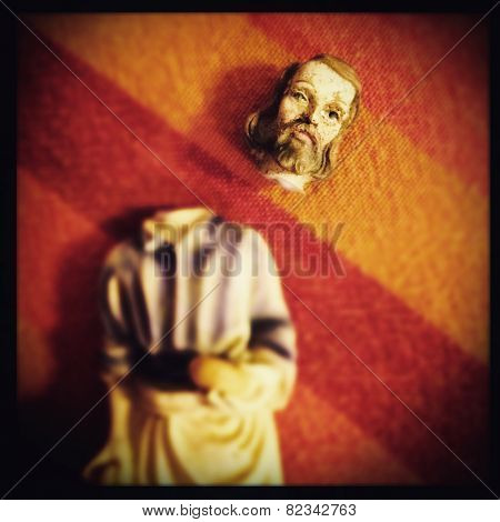 Instagram filtered image of broken Saint Joseph statue