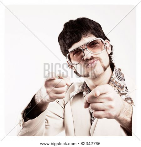 Instagram filtered image of a Retro 1970s man in a leisure suit pointing to the camera - vintage photo border