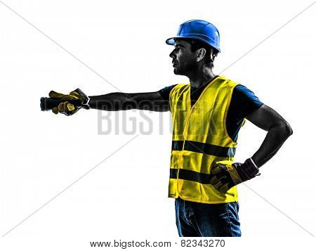 one construction worker signaling with flashlight silhouette isolated in white background