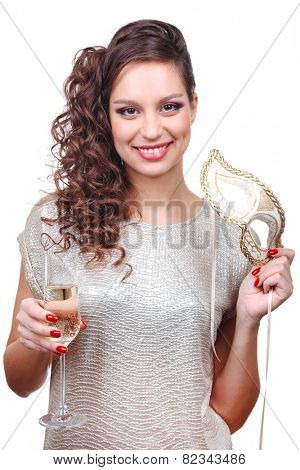 Beautiful girl with masquerade mask and glass of champagne in hand isolated on white