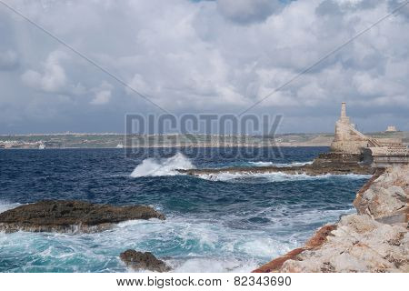 Rocky coastal inlet with breaking waves and white surf in a scenic landscape conceptual of tropical summer vacations